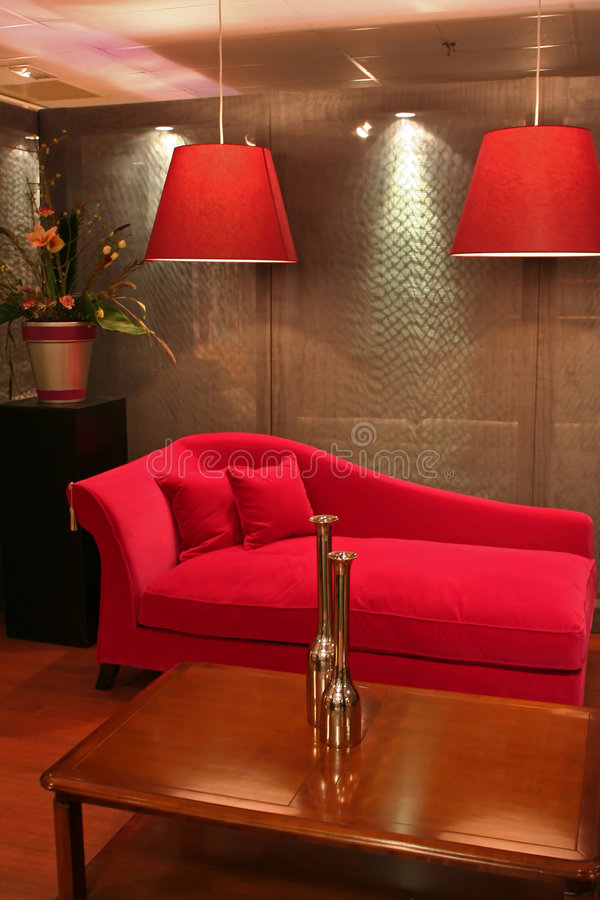 Red sofa. Modern living with red sofa in interior (focused on table with vases royalty free stock image