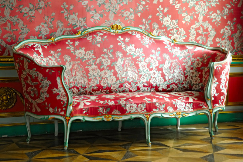 Red sofa. In old mansion royalty free stock photos