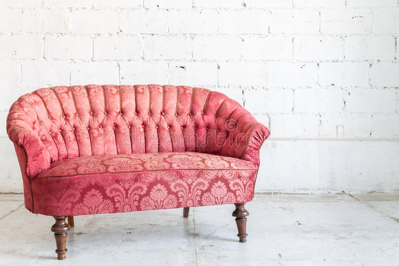 Red sofa couch. In vintage room - classical style stock image