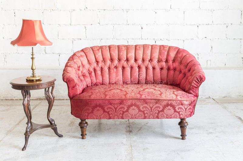 Red sofa couch. In vintage room with lamp - classical style stock photography