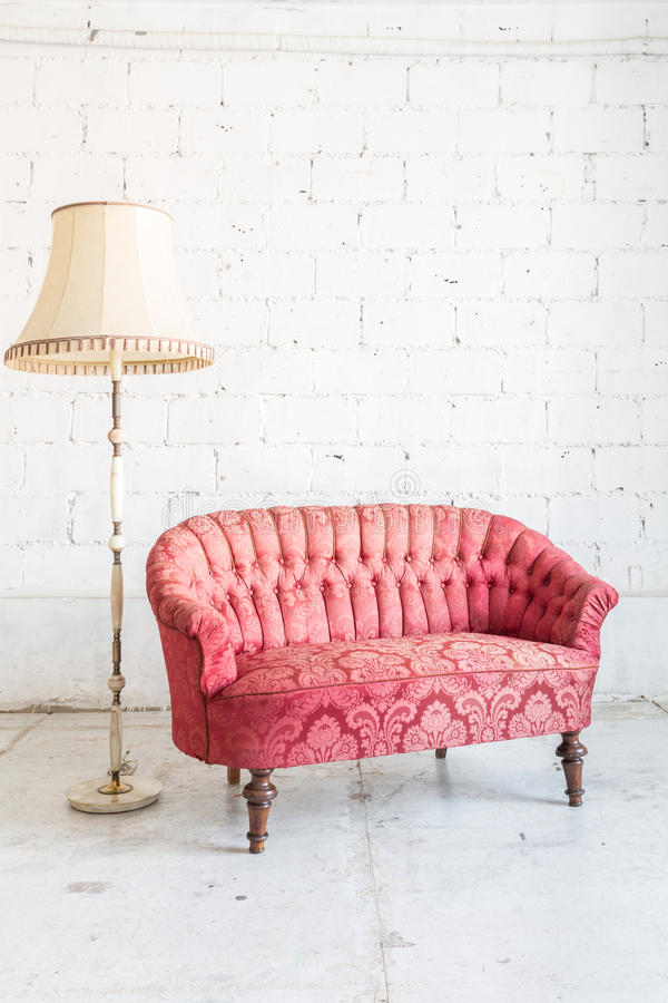 Red sofa couch. In vintage room with lamp - classical style royalty free stock images