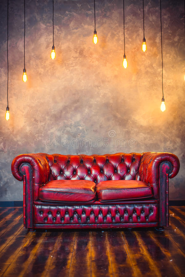 Red sofa couch. In vintage room with lamps royalty free stock photos