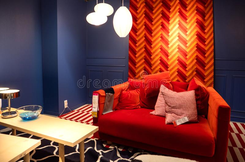 Red sofa example furniture store in IKEA royalty free stock images