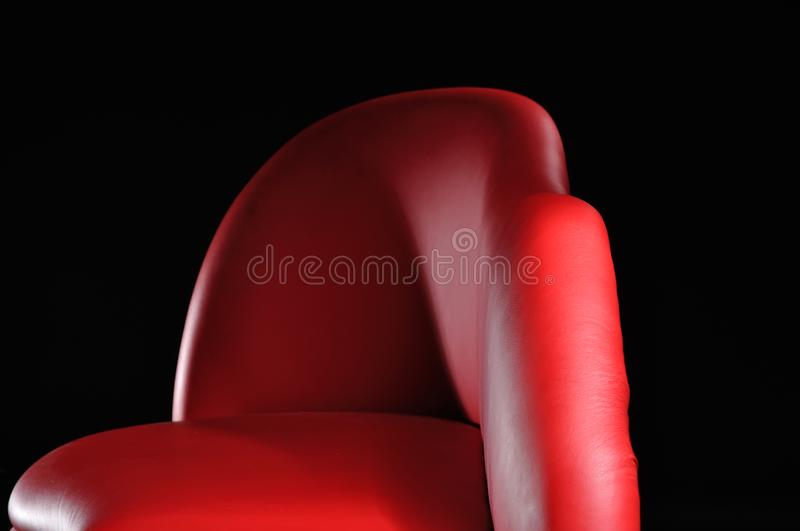 Red sofa isolated on black background. Home, lounge, style, furniture, seat, couch, chair, simple, fashion, room, wait, cushion, house, loveseat, office stock images