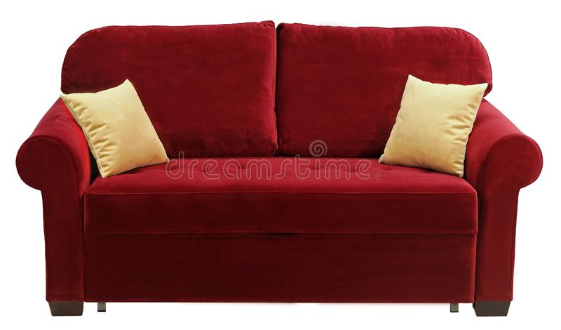 Red sofa isolated on white background. On the couch yellow decorative pillows.  stock image