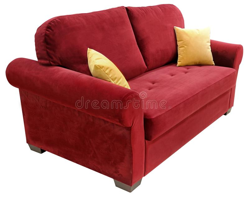 Red sofa isolated on white background. On the couch yellow decorative pillows.  royalty free stock image