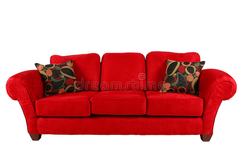 Red sofa with modern pillows stock photos