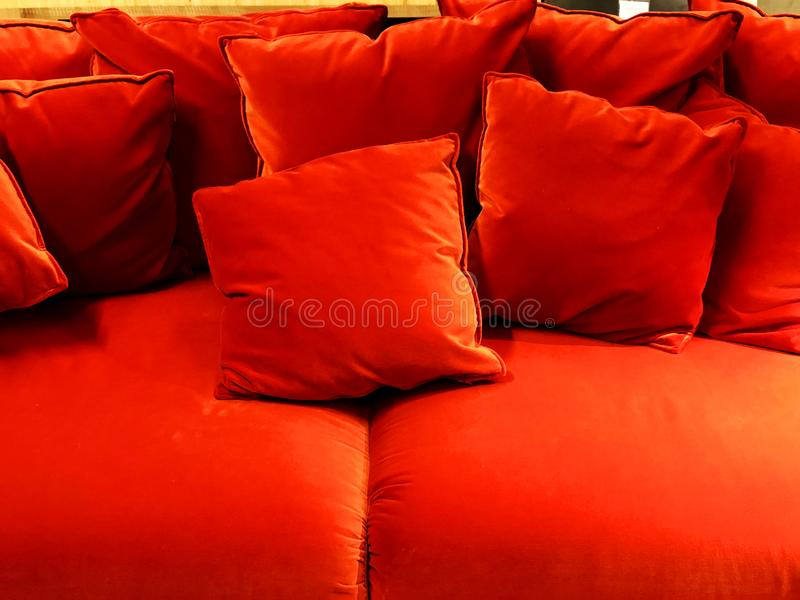 Red sofa with red cushions. Soft couch. Classic sofa. Is in the store stock photography