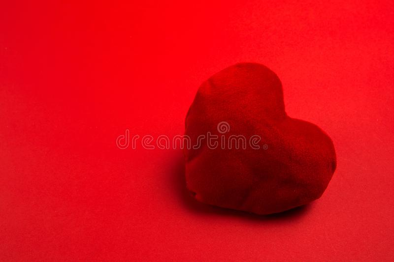 Red soft heart on red background stock photos