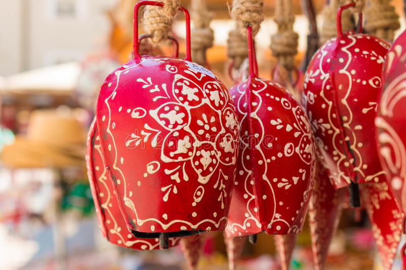 Red souvenir cow bells for sale in Salzburg, Austria. Ornate red souvenir cow bells for sale on a souvenir stand in Salzburg, Austria royalty free stock photo