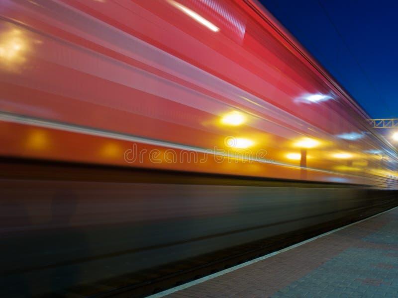 Red speeding train blur. Red speeding night train blur royalty free stock photos