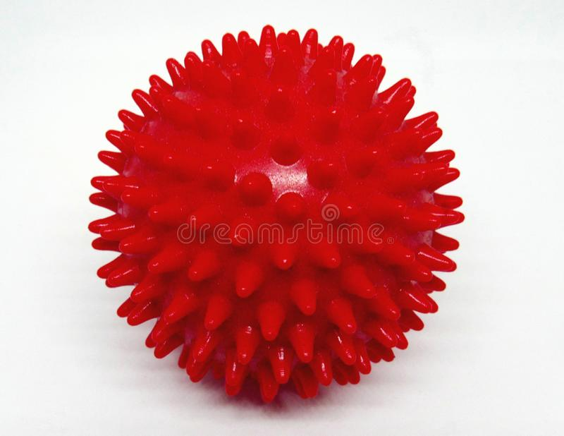 Spiky Massage Ball. Red Spiky Therapy Yoga Massage Ball royalty free stock photo