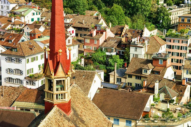 Red spire of Grossmunster and rooftops in Zurich. Switzerland royalty free stock photos