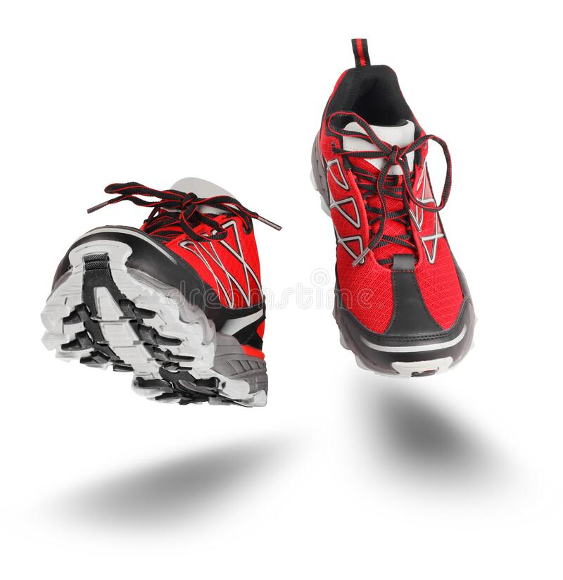 Red sport shoes running isolated on white royalty free stock photo