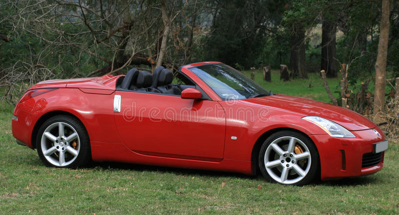 Red sports car. A red sports car with forest background royalty free stock images
