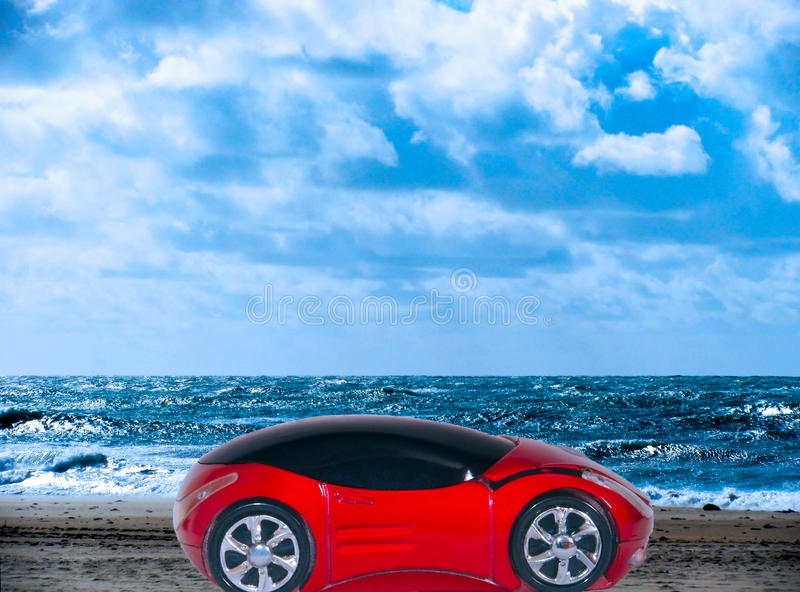 Red sports car on the beach of Cadiz. Andalusia. Spain royalty free stock photo
