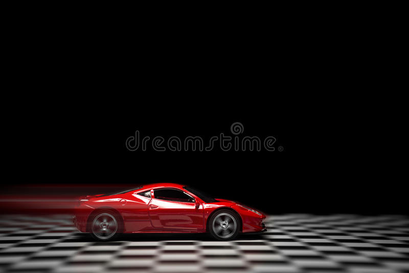 Red Sports car. On a black background and checked floor royalty free stock image