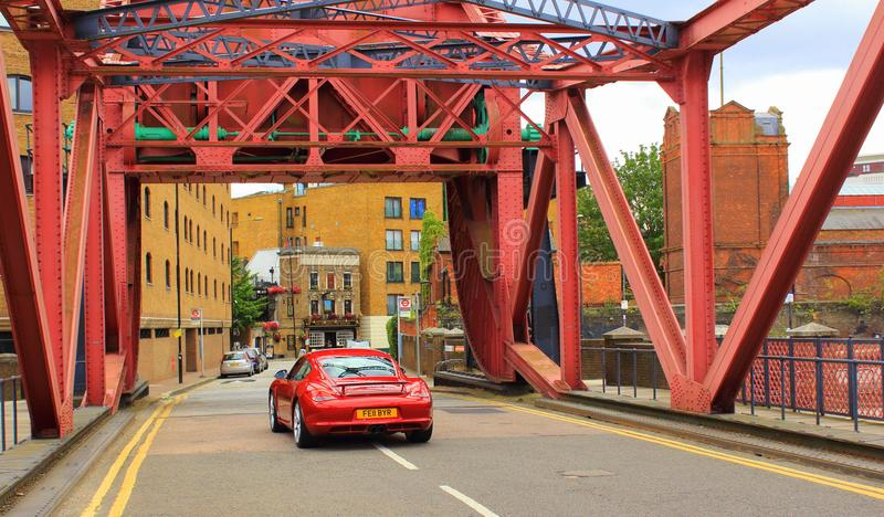 Red bridge red car Wapping Wall Central London Great Britain royalty free stock photography