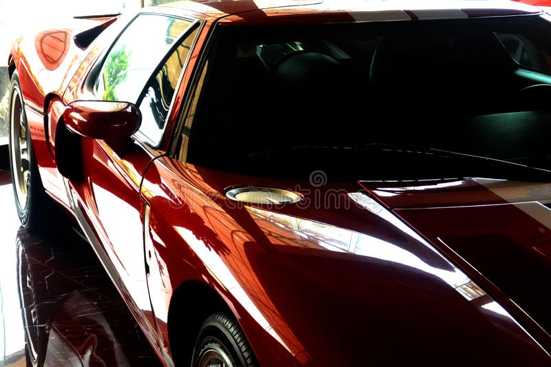 Red sports car, side and top photo. Reflection, Sihanoukville, Cambodia royalty free stock photography