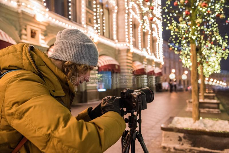 A photographer is shooting a new 30.1 megapixel full-frame mirrorless interchangeable-lens camera Canon EOS R. Red Square, Moscow, Russia - December 29, 2018: A stock image