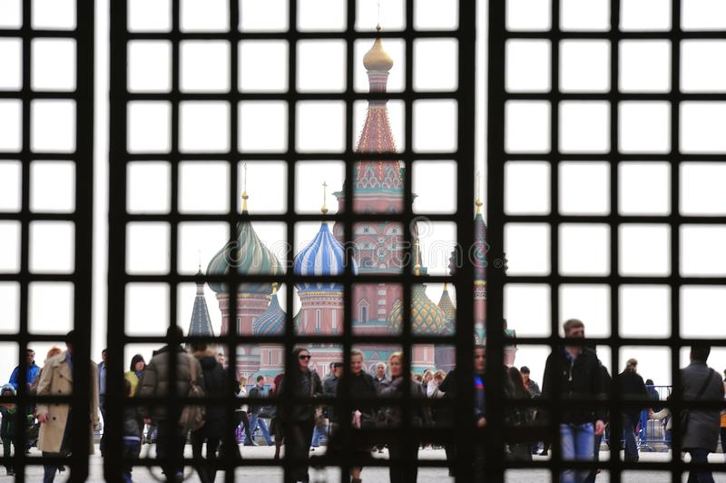 Red square in Moscow. MOSCOW, RUSSIA - MARCH 23, 2014: Red square in Moscow seen through the gate - concept of Russia under sanctions stock images
