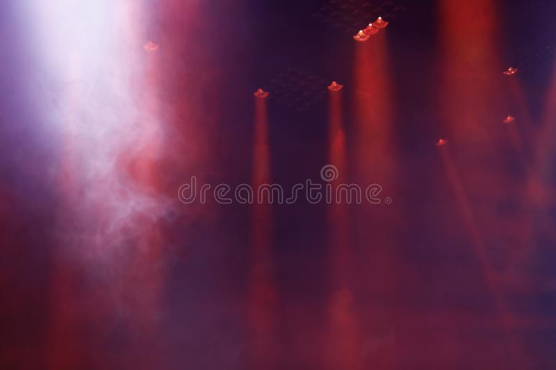 Red stage lights and smoke on concert stock images