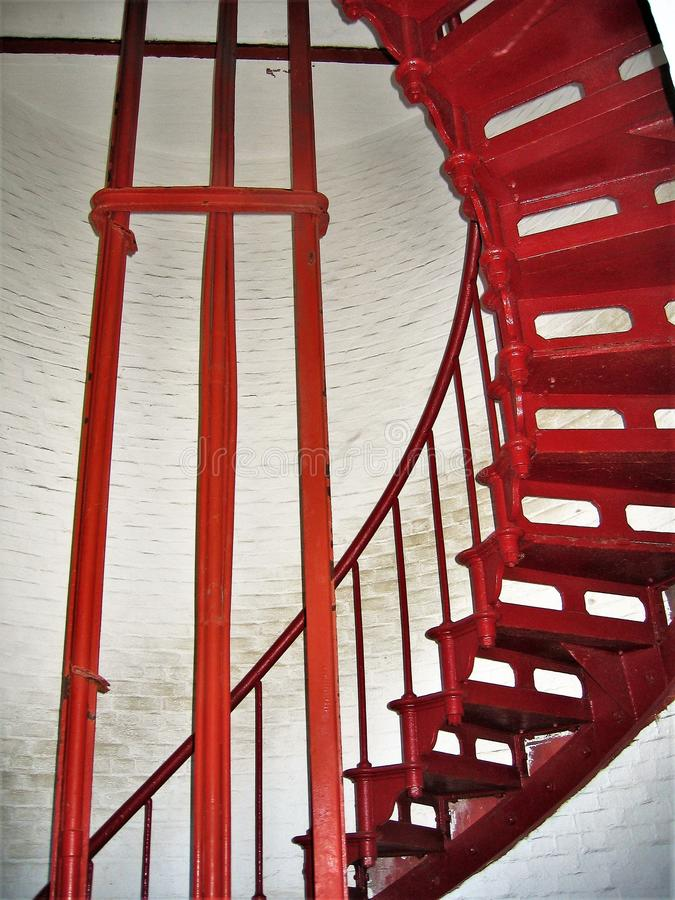 Red Staircase inside Cape Hatteras Lighthouse. Cape Hatteras Lighthouse is 198 feet tall and a climb of 268 steps will take you to the top for a view of Hatteras stock photography