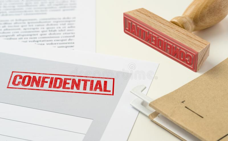 A red stamp on a document - Confidential royalty free stock image