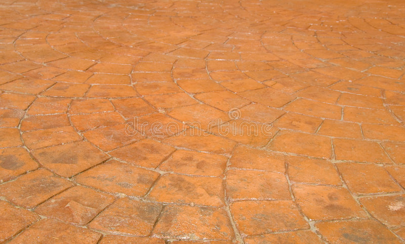 Red Stamped Concrete Patio in Backyard. Of a Residential House stock photo