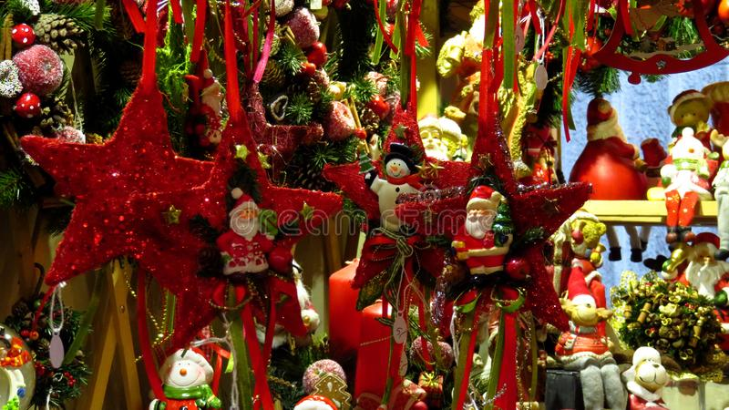 Red Star-Shaped Christmas Tree Ornaments. At a Christmas market stock photo
