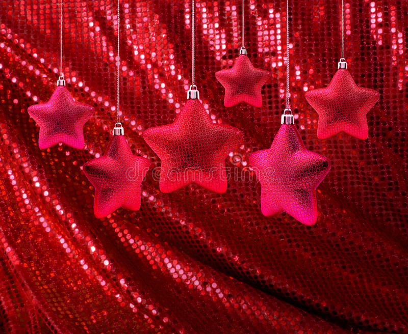 Red stars on red glitter canvas