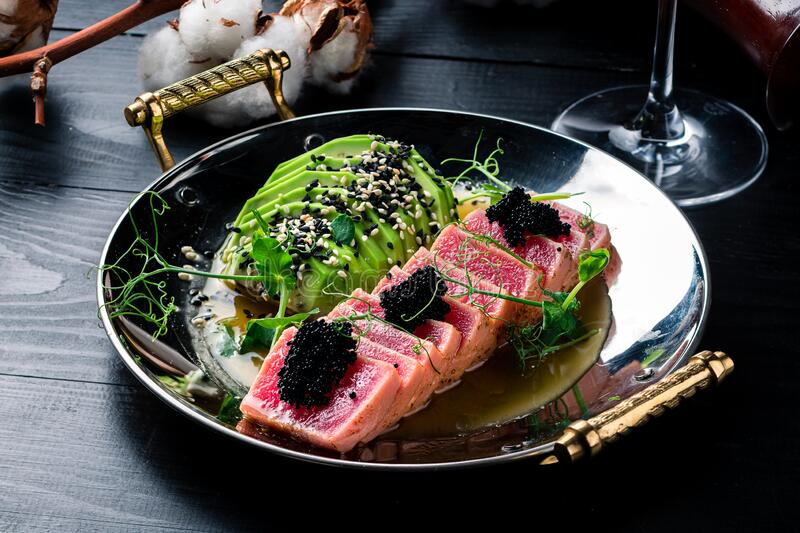 Red steak tuna grilled bbq with avocado stock photography