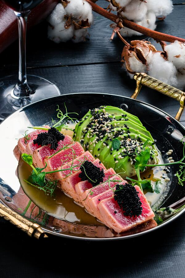 Red steak tuna grilled bbq with avocado royalty free stock images