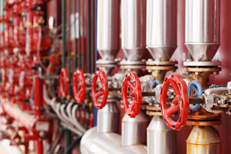 Red steam valves and pipes stock photo