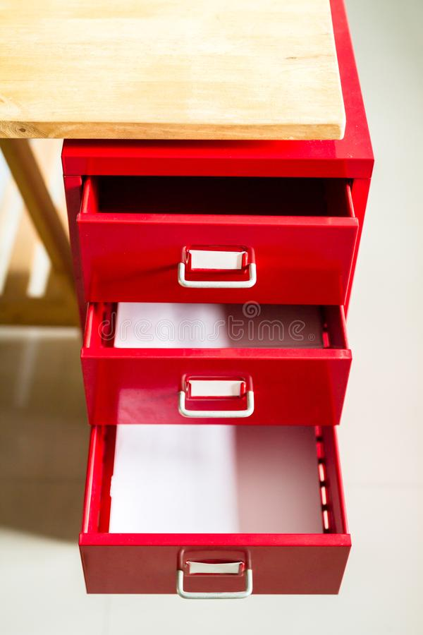 Red steel drawer for documents. stock image