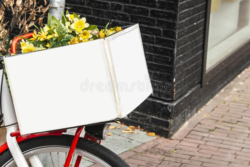 Red steel frame on the front of a bicycle with a white wooden box royalty free stock image