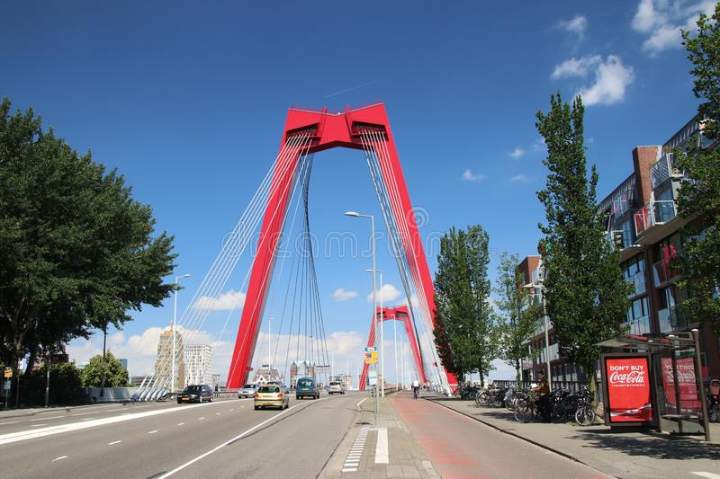 Red steel suspension bridge named Willemsbrug in the city center of Rotterdam over river Nieuwe Maas in the Netherlands stock photos