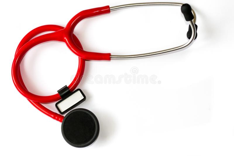 Red stethoscope with black membrane and white sticker isolated on white background. Medicine concept - instrument for auscultation stock photos
