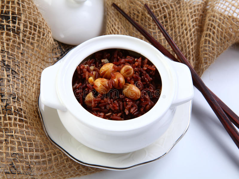 Red sticky rice with lotus bean on white bowl in restaurant stock images