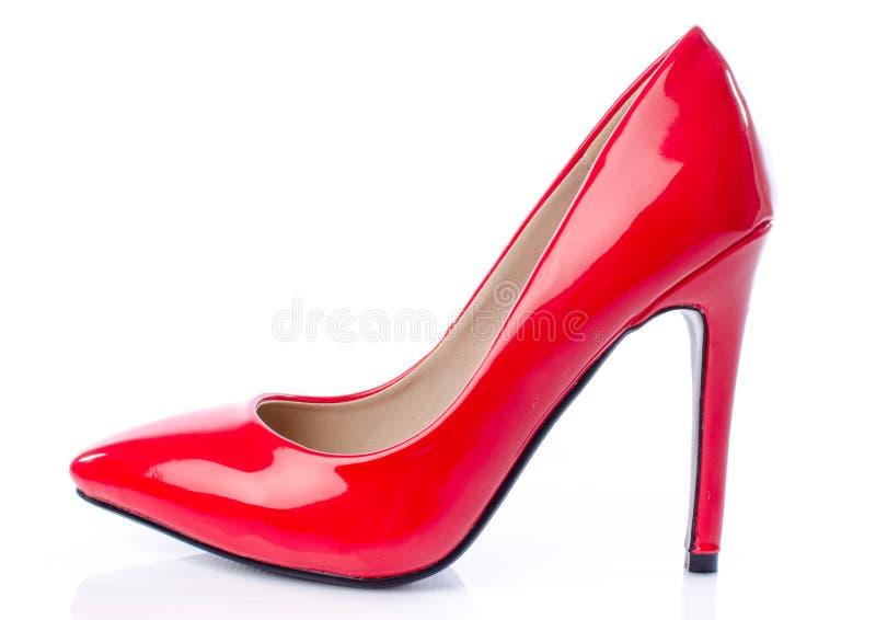 Red stiletto shoe. Isolated on white royalty free stock photos