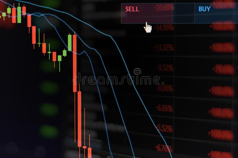 Red stock market graph be in the red on monitor chart investment be in the red trading stock exchange trading market. Screen at night time stock photo
