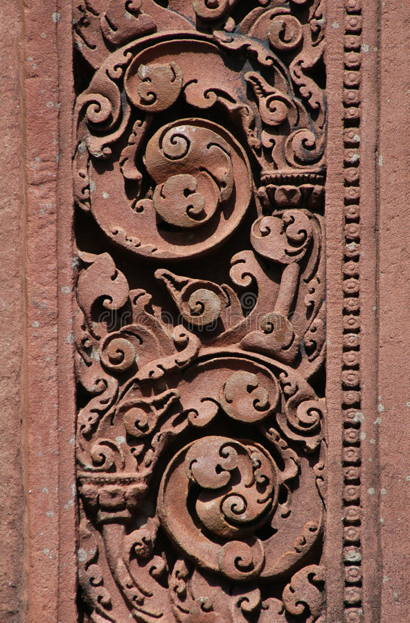 Red stone carving stock photo image of background relief