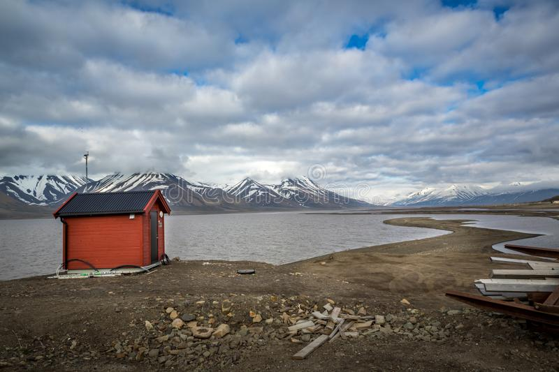 Red storage house, Longyearbyen, Advent Bay, Spitsbergen archipelago Svalbard island, Norway, Greenland Sea stock photo