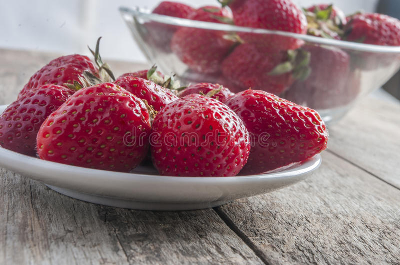 Red strawberries on old wood table. Close up royalty free stock photos