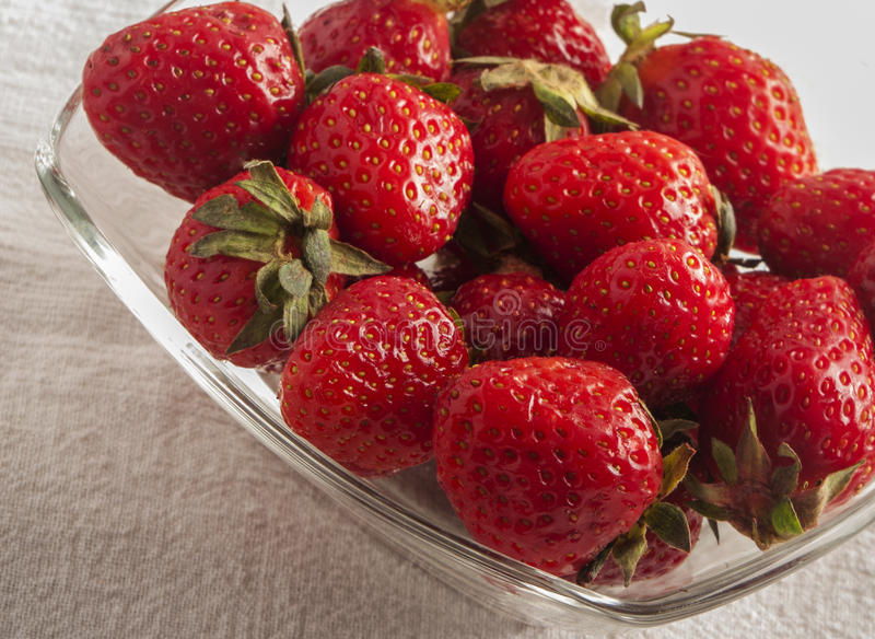 Red strawberries on old wood table. Close up stock photo