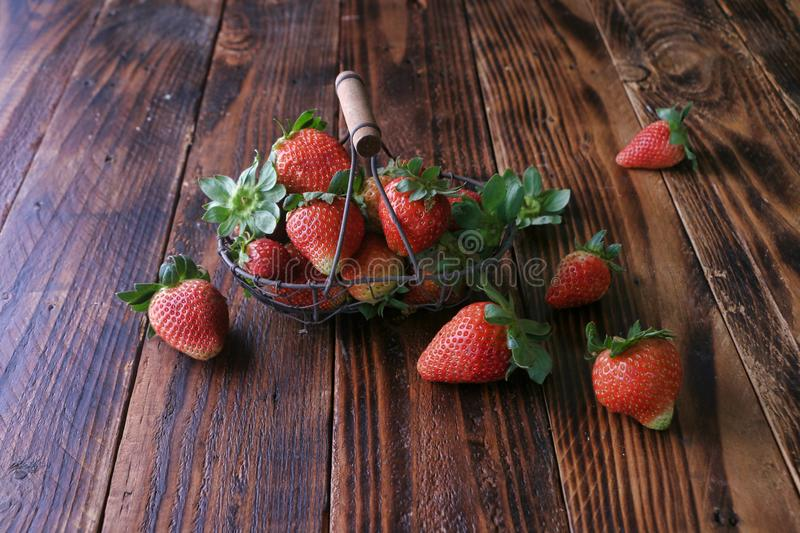 Red strawberries on wood. Red ripe strawberries on wooden surface background stock photo