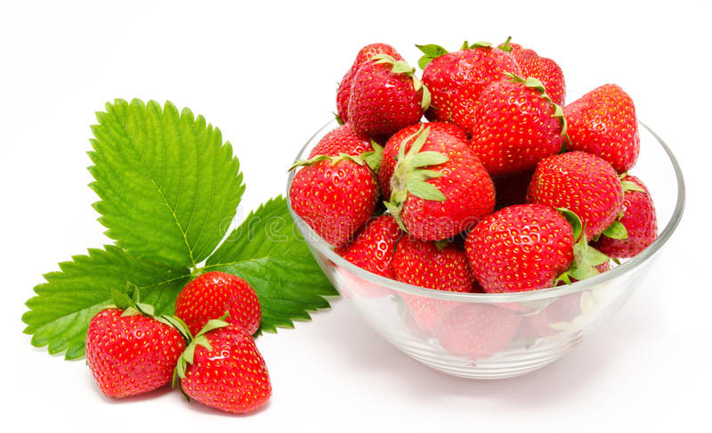 Red strawberry in the bowl. On white royalty free stock photos
