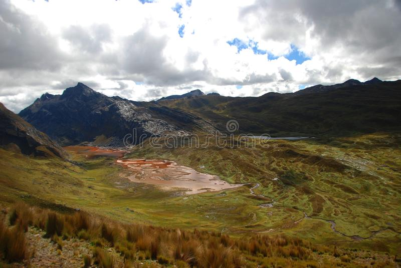 Red stream within mountains royalty free stock image