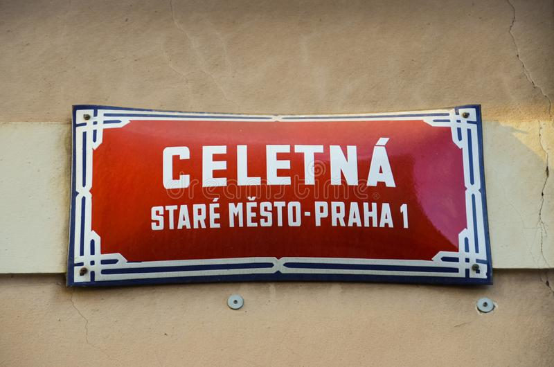 Red street sign in Prague, Czech Republic with white text: Celetna street, Old Town, Prague 1. Orientation signs, city center. Building facade royalty free stock photography