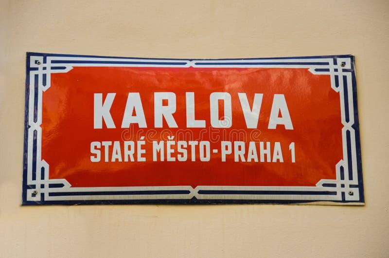 Red street sign in Prague, Czech Republic with white text: Karlova street, Old Town, Prague 1. Orientation signs, city center. Building facade. Praga, Czechia royalty free stock photos